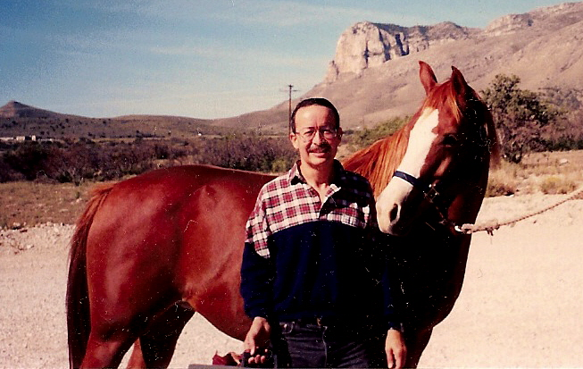 Erick in October, 1994, grooming Lady prior to riding at Guadalupe Peak